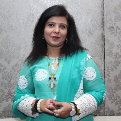 Dr. Madhu Kotia - Renowned tarot card reader, Numerologist, Energy Vastu expert and Spiritual and Psychic Healer